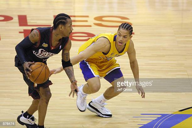 Tyronn Lue of the Los Angeles Lakers defends Allen Iverson of the Philadelphia 76ers in game two of the NBA Finals at Staples Center in Los Angeles...