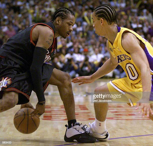 Tyronn Lue of the Los Angeles Lakers guards Allen Iverson of the Philadelphia 76ers during Game 1 of the NBA Finals at Staples Center in Los Angeles...