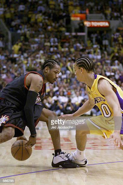 Tyronn Lue of the Los Angeles Lakers guards Allen Iverson of the Philadelphia 76ers in game one of the NBA Finals at Staples Center in Los Angeles...