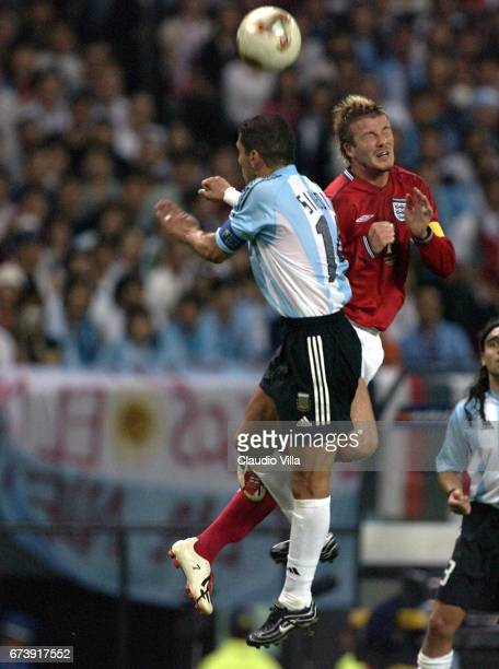 David Beckham of England and Diego Simeone of England during the first half of the England v Argentina Group F World Cup Group Stage match played at...