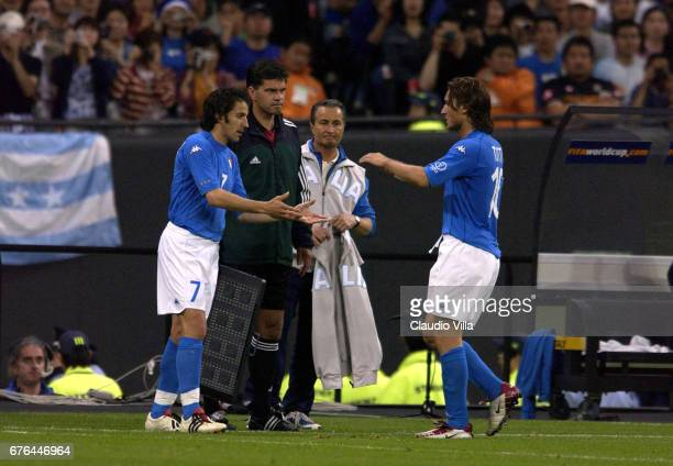 Alessandro Del Piero of Italy goes in for team mate Francesco Totti during the Italy v Ecuador Group G Korea and Japan World Cup Group Stage match...