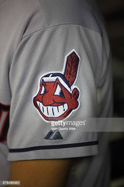 the Chief Wahoo mascot insigna on the Cleveland Indians uniforms that Native Americans are protesting is shown during a regular season game between...