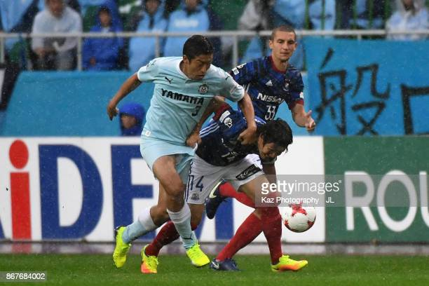 Jun Amano of Yokohama FMarinos and Kentaro Oi of Jubilo Iwata compete for the ball during the JLeague J1 match between Jubilo Iwata and Yokohama...