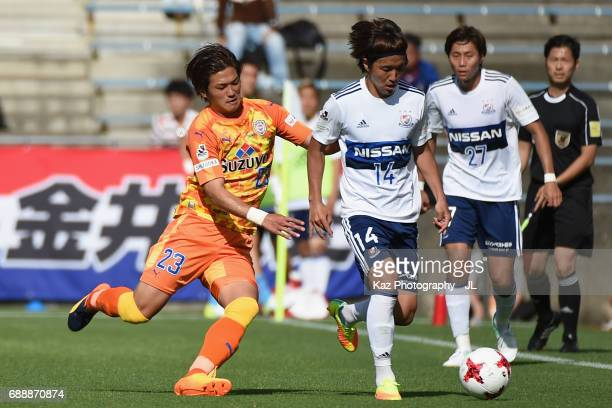 Jun Amano of Yokohama FMarinos and Koya Kitagawa of Shimizu SPulse compete for the ball during the JLeague J1 match between Shimizu SPulse and...