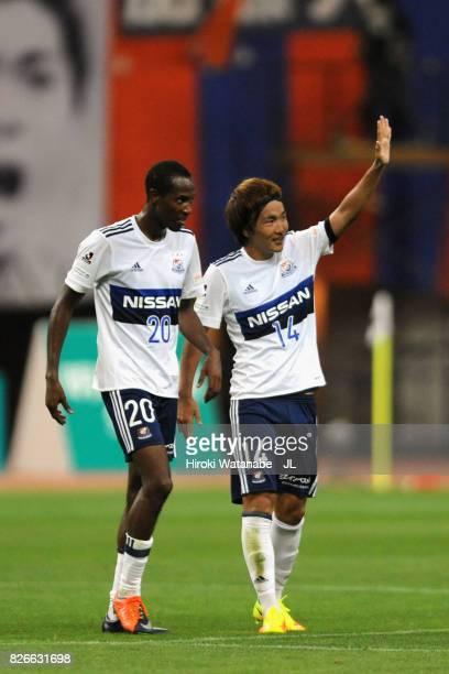 Jun Amano of Yokohama FMarinos celebrates scoring his side's second goal with his team mate Martinus during the JLeague J1 match between Albirex...