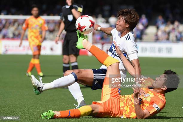 Jun Amano of Yokohama FMarinos is challenged by Ryohei Shirasaki of Shimizu SPulse during the JLeague J1 match between Shimizu SPulse and Yokohama...