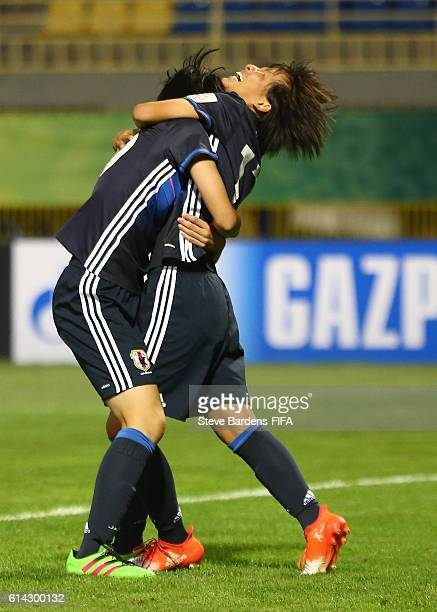Jun Endo of Japan celebrates scoring a goal with her team mates during the FIFA U17 Women's World Cup Jordan 2016 quarter final match between Japan...