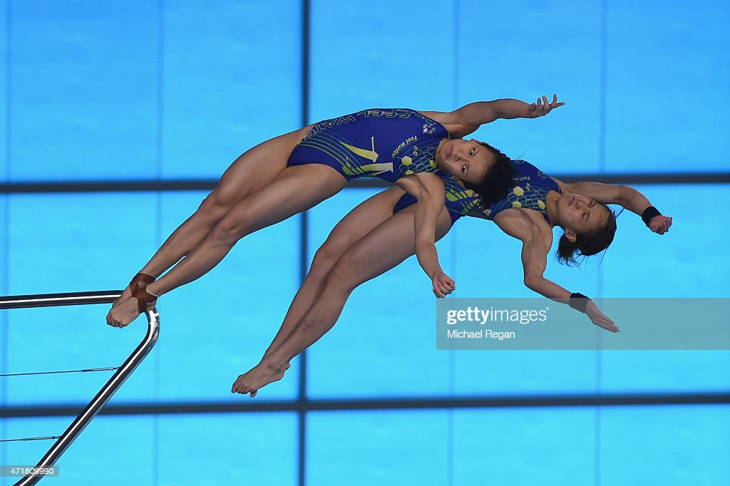 Jun Hoong Cheong and Mun Yee Leong of Malaysia compete in the Women's 10 meter synchro during the FINA/NVC Diving World Series at the Aquatics Centre on May 1, 2015 in London, England.
