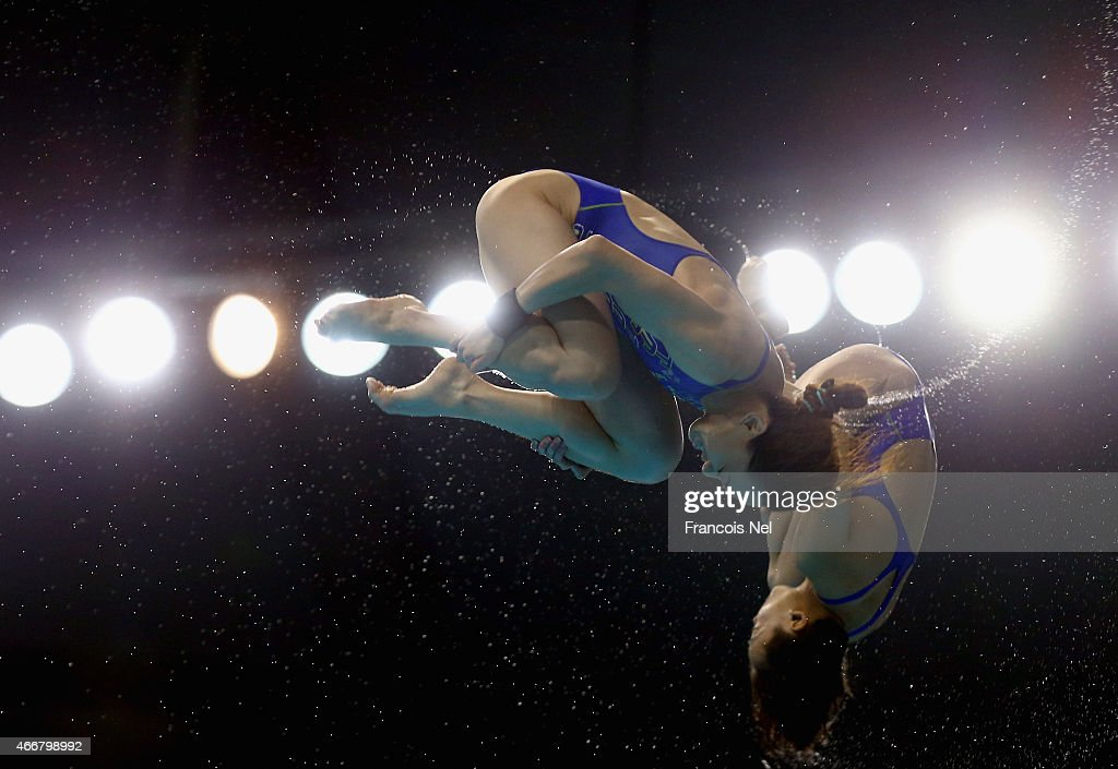 Jun Hoong Cheong and Mun Yee Leong of Malaysia dives in the Women's 10m Synchro Platform Final during day one of the FINA/NVC Diving World Series 2015 at the Hamdan Sports Complex on March 19, 2015 in Dubai, United Arab Emirates.