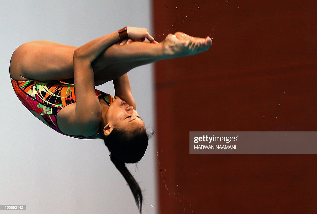 Jun Hoong Cheong of Malaysia dives to win the bronze medal of the women's 3m springboard competition at the 9th Asian Swimming Championships in Dubai on November 24, 2012. AFP PHOTO/MARWAN NAAMANI