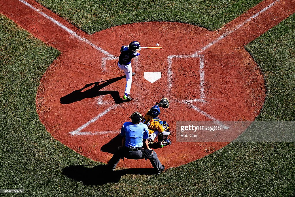 Jun Hyeok Yun #2 of Team Asia-Pacific follows his hit against the Great Lakes Team from Chicago, Illinois during the Little League World Series Championship game at Lamade Stadium on August 24, 2014 in South Williamsport, Pennsylvania.