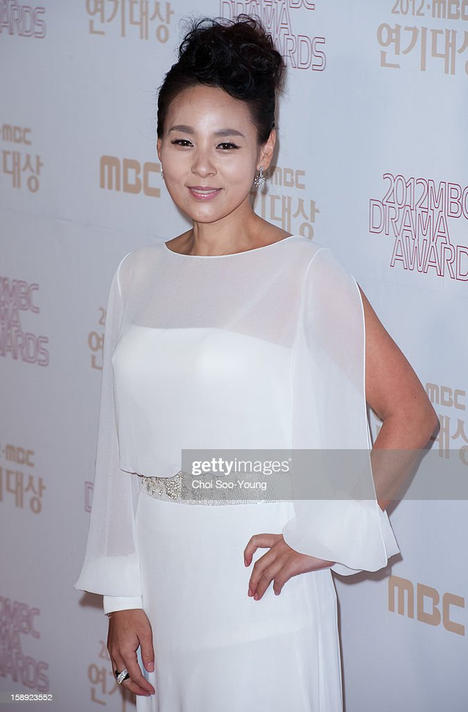 Jun Mi-Sun poses for photographs upon arrival during the 2012 MBC Drama Awards at MBC Open Hall on December 30, 2012 in Seoul, South Korea.