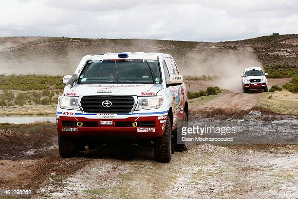 Jun Mitsuhashi of Japan and Alain Guehennec of France for Team Land Cruiser Toyota Auto Body VDJ200 followed by Nicolas Gibon of France and Akira...