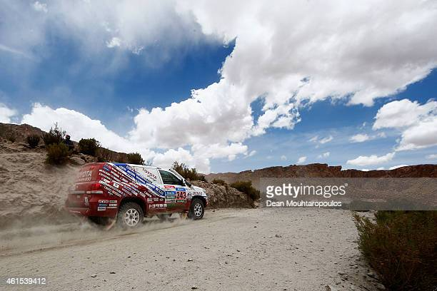 Jun Mitsuhashi of Japan and Alain Guehennec of France for Team Land Cruiser Toyota Auto Body VDJ200 compete near the Salinas Grandes during Stage 10...