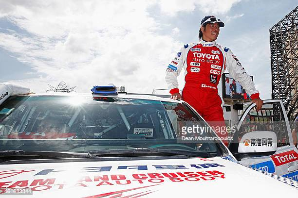 Jun Mitsuhashi of Japan for Team Land Cruiser Toyota Auto Body VDJ200 greets the fans prior to entering the podium during Day 14 of the Dakar Rally...