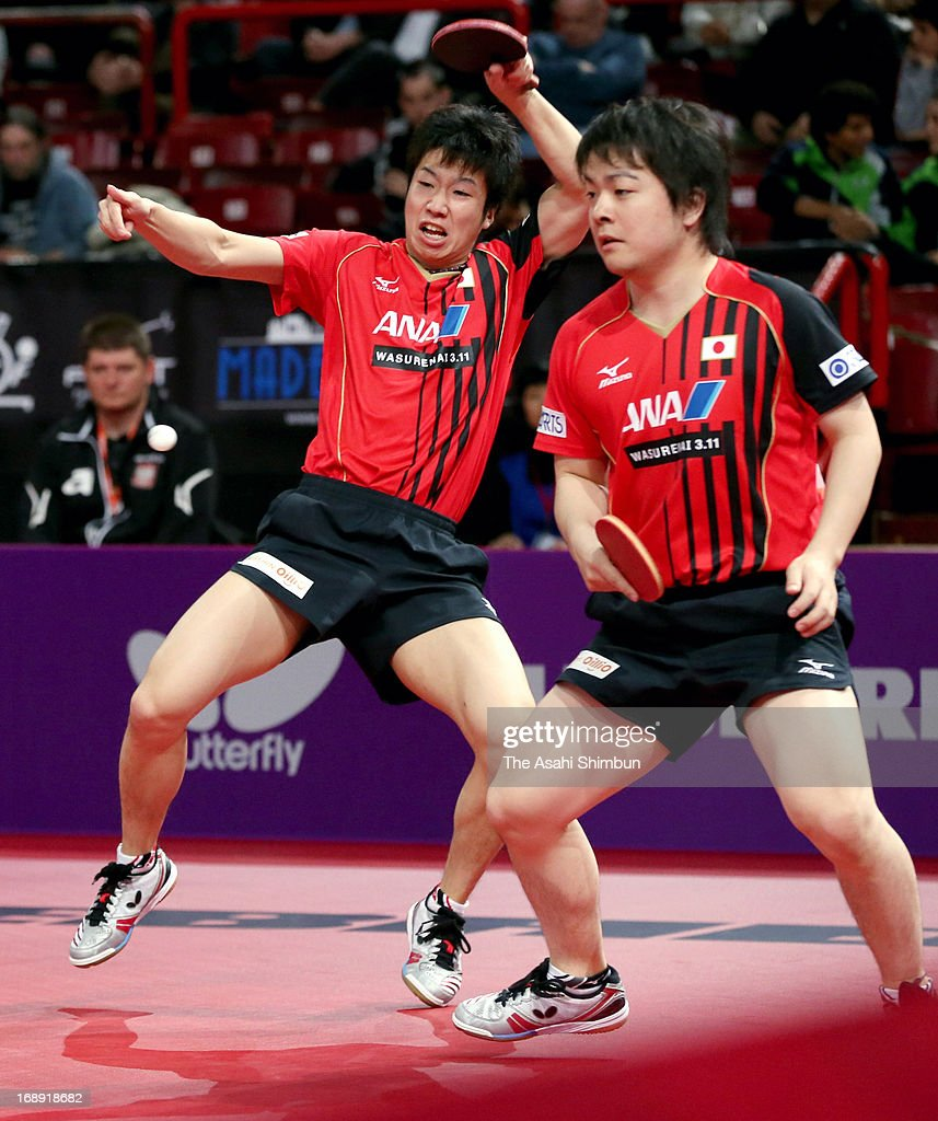 <a gi-track='captionPersonalityLinkClicked' href=/galleries/search?phrase=Jun+Mizutani&family=editorial&specificpeople=2161469 ng-click='$event.stopPropagation()'>Jun Mizutani</a> (L) and <a gi-track='captionPersonalityLinkClicked' href=/galleries/search?phrase=Seiya+Kishikawa&family=editorial&specificpeople=665374 ng-click='$event.stopPropagation()'>Seiya Kishikawa</a> of Japan compete against Pawel Fertikowski and Zengyi Wang of Poland in the Men's Doubles 1st round during day four of the World Table Tennis Championships on May 16, 2013 in Paris, France.