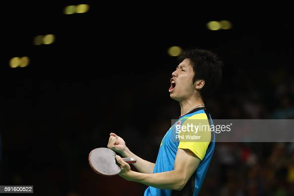 Jun Mizutani of Japan celebrates during the Men's Table Tennis gold medal match against Xin Xu of China at Riocentro Pavilion 3 on Day 12 of the Rio...