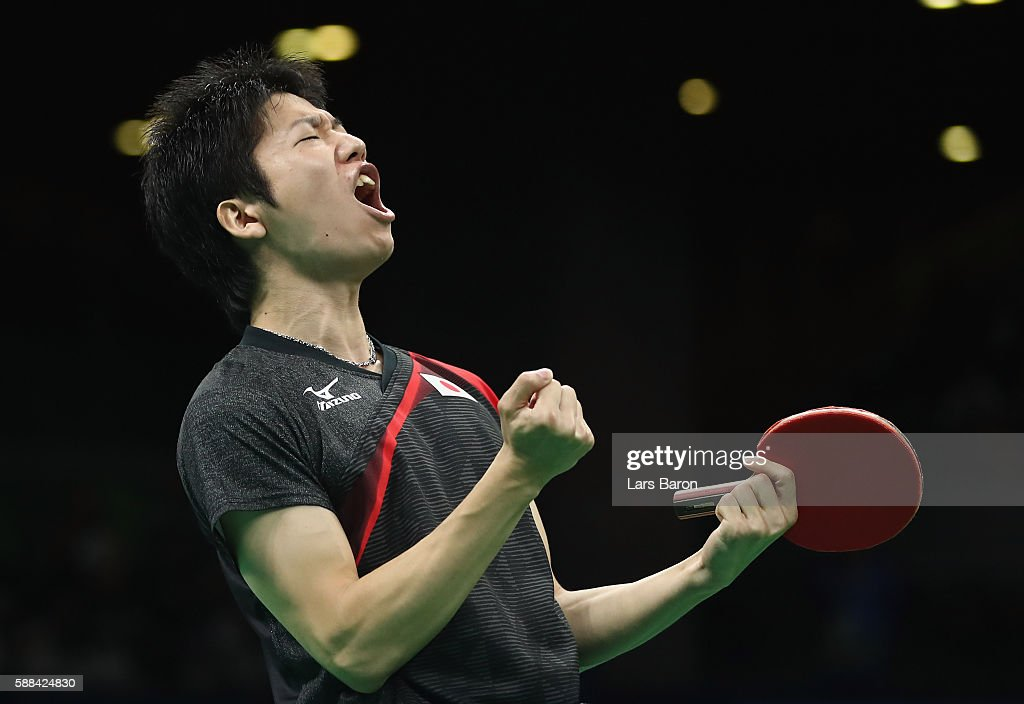 Jun Mizutani of Japan celebrates during the Mens Table Tennis Singles Semifinal match between Ma Long of China and Jun Mizutani of Japan at Rio Centro on August 11, 2016 in Rio de Janeiro, Brazil.