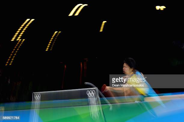 Jun Mizutani of Japan competes against Bastian Steger of Germany during the Table Tennis Men's Team Round Semi Final between Japan and Germany during...