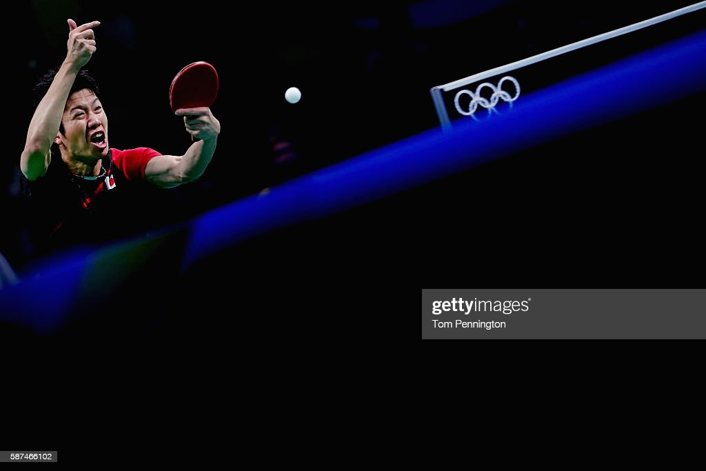 Jun Mizutani of Japan competes against Hugo Calderano of Brazil during Round 4 of the Men's Singles Table Tennis on Day 3 of the Rio 2016 Olympic Games at Riocentro - Pavilion 3 on August 8, 2016 in Rio de Janeiro, Brazil.