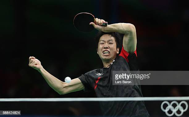 Jun Mizutani of Japan competes during the Mens Table Tennis Singles Semifinal match between Ma Long of China and Jun Mizutani of Japan at Rio Centro...