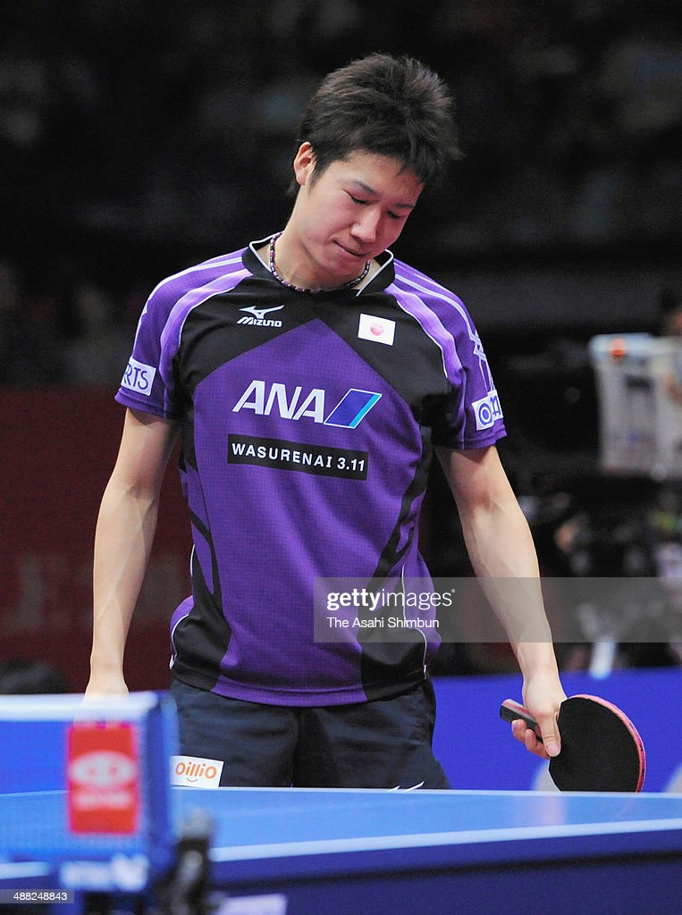 <a gi-track='captionPersonalityLinkClicked' href=/galleries/search?phrase=Jun+Mizutani&family=editorial&specificpeople=2161469 ng-click='$event.stopPropagation()'>Jun Mizutani</a> of Japan reacts after losing a point at the semi final game against Timo Boll of Germany during day seven of the 2014 World Team Table Tennis Championships at Yoyogi National Gymnasium on May 4, 2014 in Tokyo, Japan.