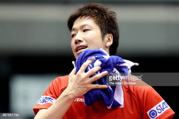 Jun Mizutani of Japan reacts during the men's singles semi final match against Zhendong Fan of China on day five of the 2017 ITTF World Tour Platinum...