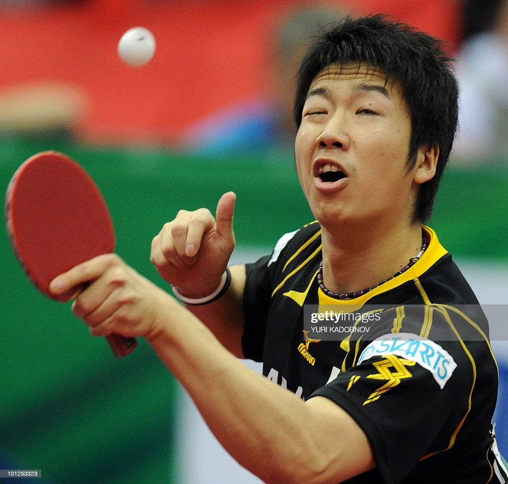 Jun Mizutani of Japan returns a service to Ma Long of China during the men's semi final at the 2010 World Team Table Tennis Championships in Moscow on May 29, 2010.