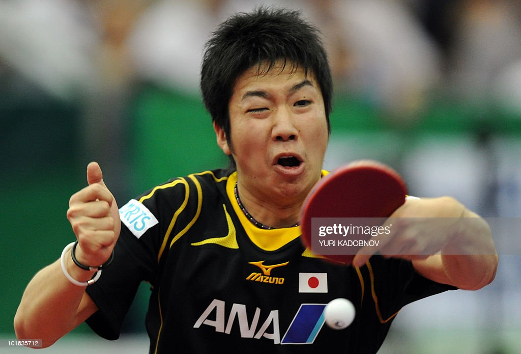 Jun Mizutani of Japan returns a service