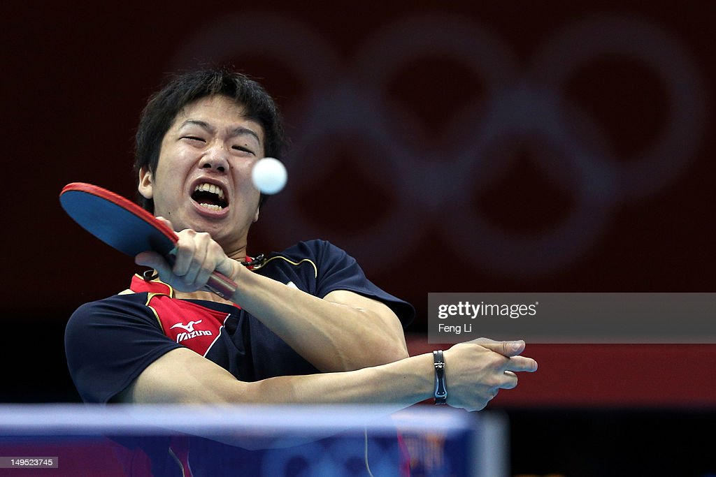 Jun Mizutani of Japan returns the ball during his Men's Singles Table Tennis third round match against Elsayed Lashin of Egypt on Day 3 of the London 2012 Olympic Games at ExCeL on July 30, 2012 in London, England.