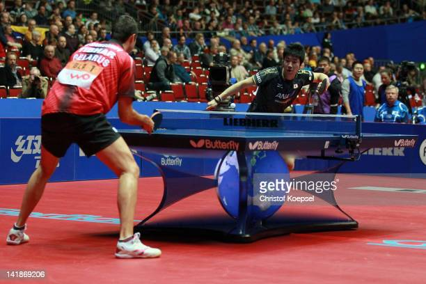 Jun Mizutani of Japan serves during his match against Vladimir Samsonov of Belarus during the LIEBHERR table tennis team world cup 2012 championship...