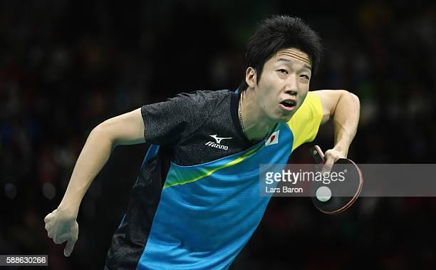 Jun Mizutani of Japan serves during the Mens Table Tennis Bronze Medal match between Jun Mizutani and Vladimir Samsonov of Belarus at Rio Centro on...