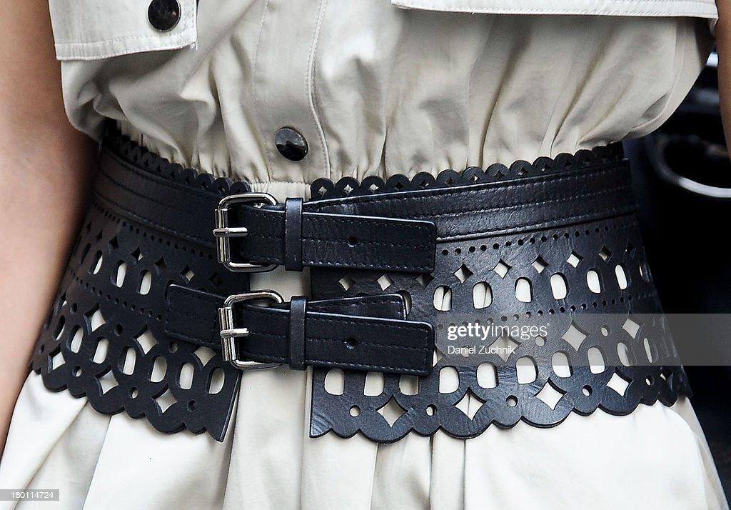 Jun Olivia (Belt detail) is seen outside the DKNY show wearing a BCBG belt on September 8, 2013 in New York City.