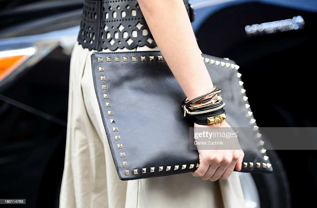 Jun Olivia (Bag detail) is seen outside the DKNY show wearing an Opening Ceremony dress, BCBG belt and Valentino bag on September 8, 2013 in New York City.
