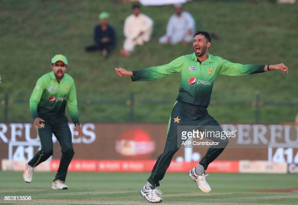 Junaid Khan celebrates with teammates after dismissing Chamara Kapugedera of Sri Lanka during the third one day international match between Pakistan...
