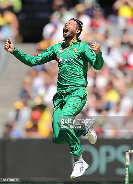 Junaid Khan of Pakistan celebrates after dismissing Usman Khawaja of Australia during game two of the One Day International series between Australia...