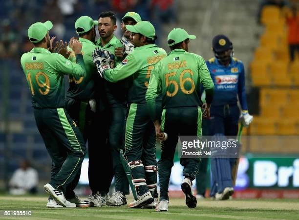Junaid Khan of Pakistan celebrates with teammates after dismissing Niroshan Dickwella of Sri Lanka during the second One Day International match...