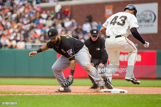 Pittsburgh Pirates first baseman Pedro Alvarez loses control of the ball as San Francisco Giants right fielder Justin Maxwell makes it safely on base...