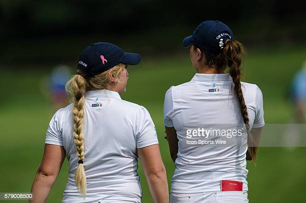 Eilidh Briggs of Team Great Britain and Ireland and Gabriella Cowley of Team Great Britain and Ireland chat as they walk down the fairway during the...