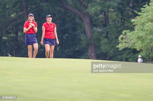 Erynne Lee of Team USA and Annie Park of Team USA chat as they walk down the fairway during the 2014 Curtis Cup match at St Louis Country Club in St...