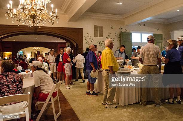 Curtis Cup patrons take shelter in the clubhouse due to inclement weather during the 2014 Curtis Cup match at St Louis Country Club in St Louis...