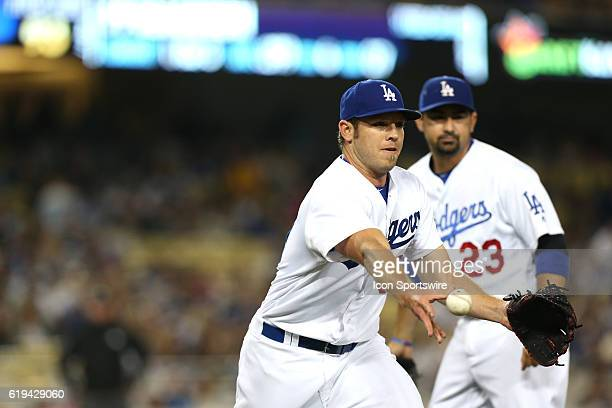Los Angeles Dodgers Pitcher Casey Fien [9006] tosses the ball to first base during the game against the Colorado Rockies at Dodger Stadium in Los...