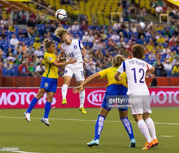 Korea midfielder Kang Yumi and Brazil defender Tamires fight for the ball during the 2015 FIFA Women's World Cup Group E match between Brazil and...