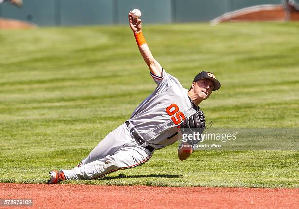 Oregon State infielder Andy Peterson throws to first base after slipping making a play on the ball during the NCAA Div 1 Championship Corvallis...