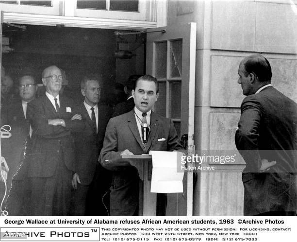 Governor George Wallace speaks in the doorway of a campus building at the University of Alabama in Tuscaloosa publicly refusing to allow African...