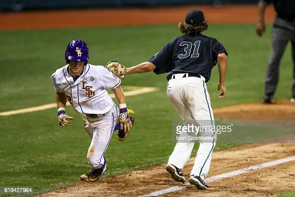 June 11 2016 LSU infielder Cole Freeman is caught in a rundown until Coastal Carolina pitcher Bobby Holmes is able to tag him out during the NCAA DIV...