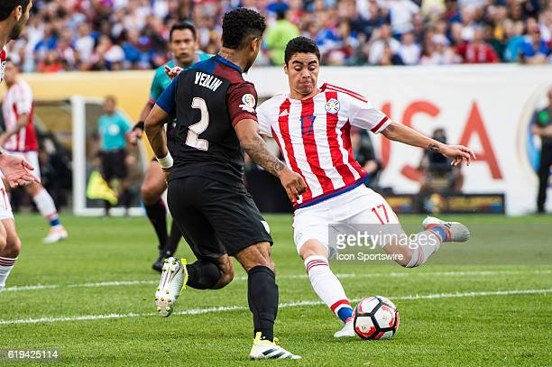 Paraguay midfielder Miguel Almiron attempt a pass and is defended by United States defender DeAndre Yedlin during the 1st half of the match between...