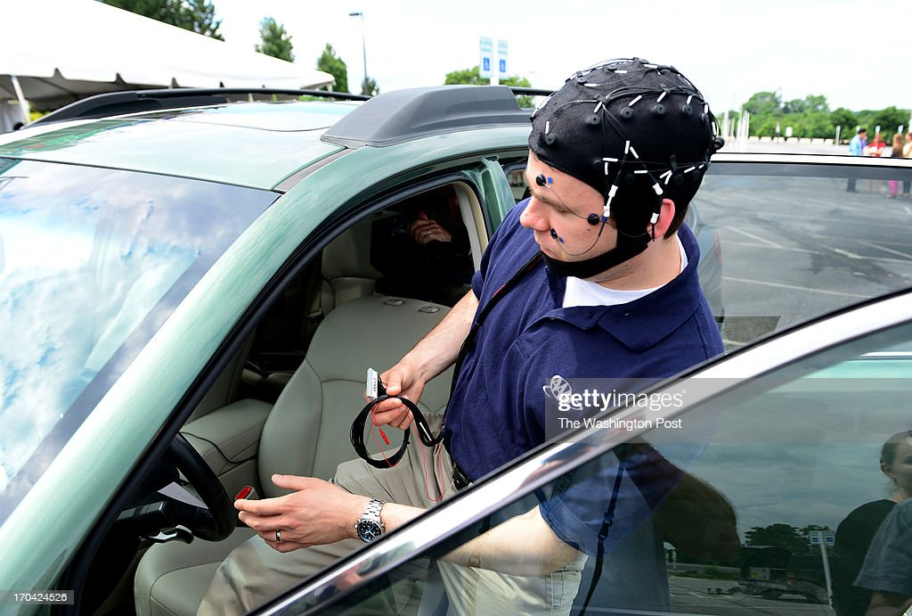 Russ Martin of AAA, wearing a EEG-configured skull cap, prepares to drive their research vehicle as they unveil peer-reviewed research demonstrating that new in-car technologies being marketed by automakers can cause dangerous mental distractions for drivers on June 11, 2013 in Landover, MD