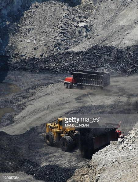 A June 12 2008 photo shows coal being loaded onto a truck at a coal mine on top of Kayford Mountain in West Virginia The mountain top has been...