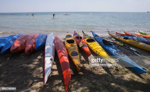 TORONTO June 12 2017 People enjoy paddling in the Lake Ontario during the 2017 Toronto Paddlefest in Toronto Canada June 11 2017 Thousands of people...